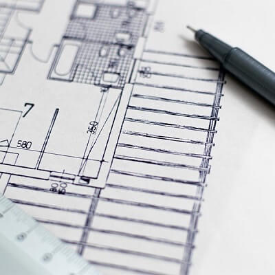 Pen and paper with blueprints for new home in Texas